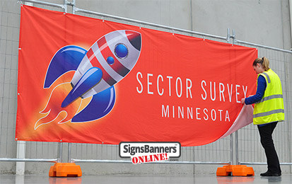Custom orange banner sign with rocket design and person MINNESOTA MN USA.