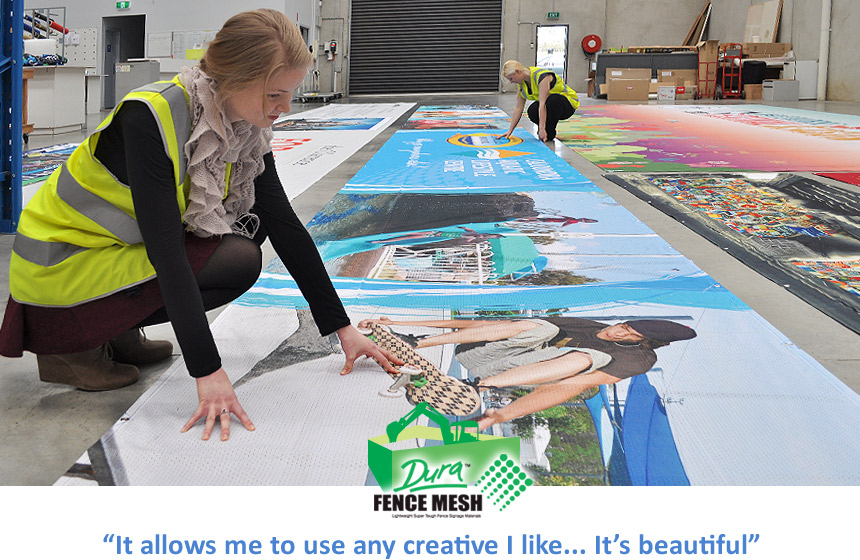 A girl looking at the long banner printing and creative sign printing used around the packaging department of all the colors on the banner signs.