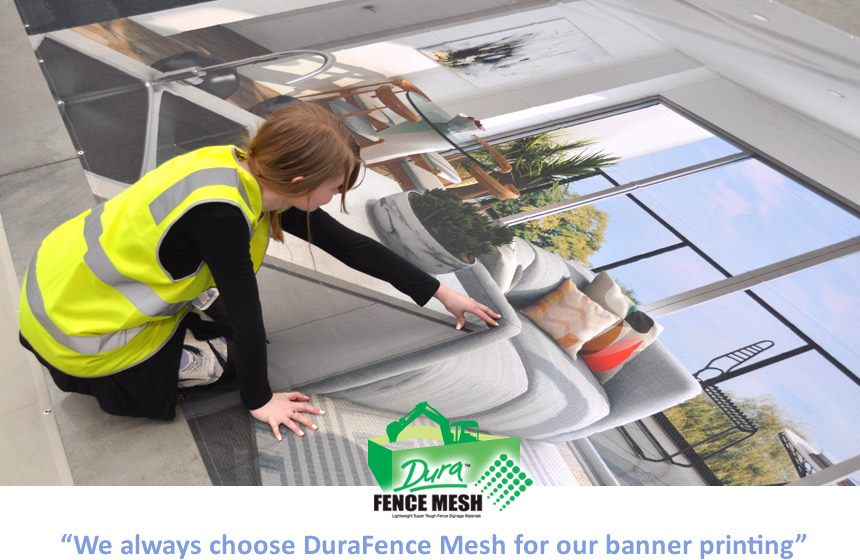 Girl pointing to the fine detail achieved when printing using the DuraFence Mesh banner printing products. Here, the scene is the interior design of a new home.