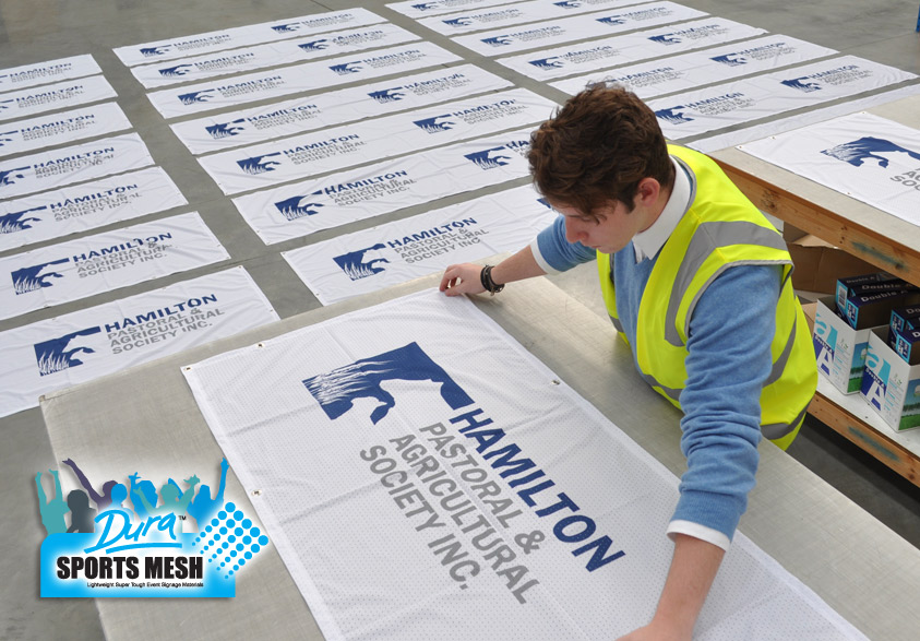 Inside the factory with hundreds of locality signage flags being processed.