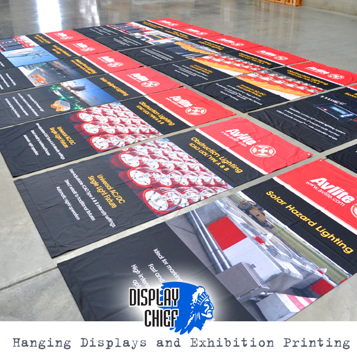Series of hanging banner signs for display.