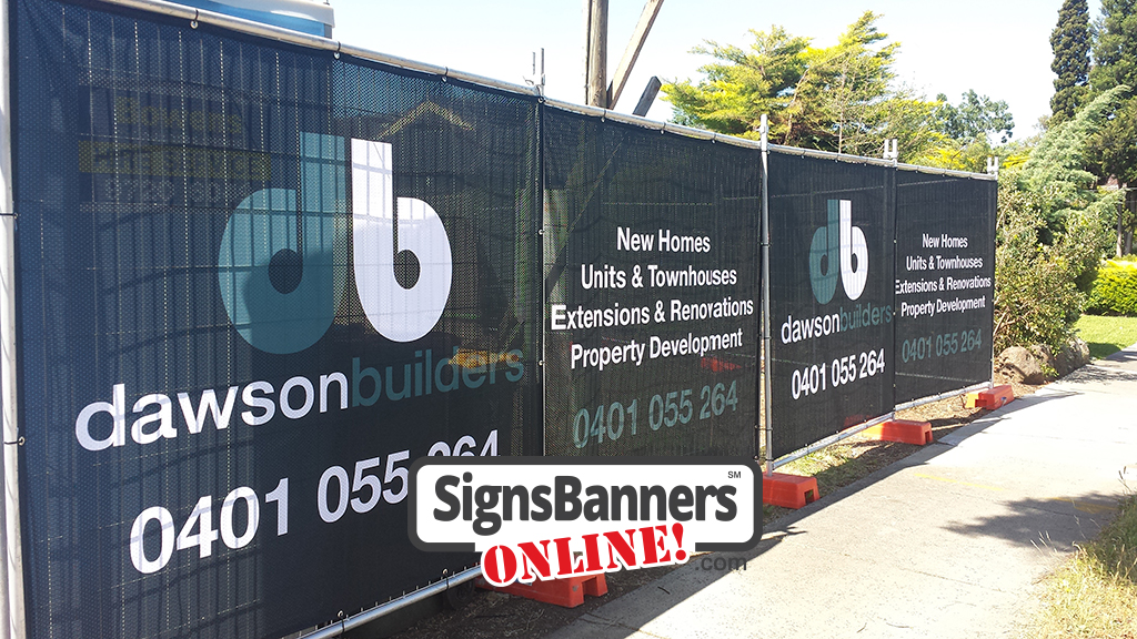Angled photo of medium banner prints customize to suit your barrier fence or rental fencing structures, these custom banner signs are printed on mesh material for a building company.