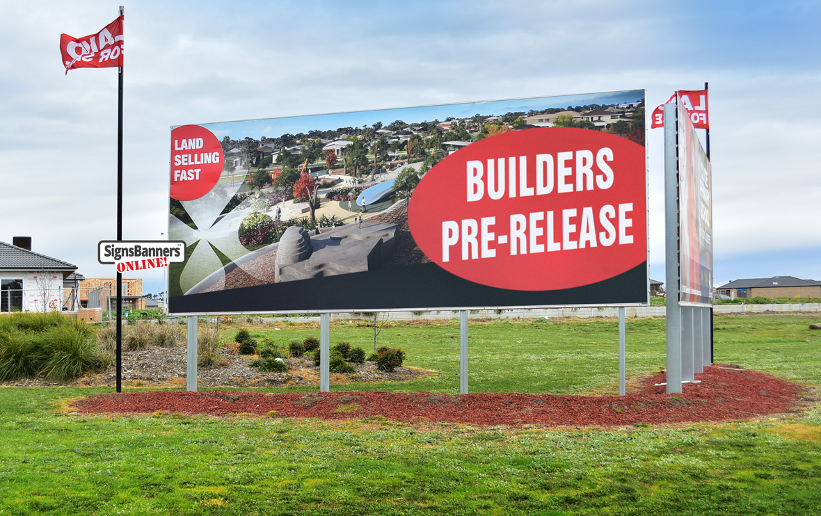 Land and Realty builders billboard with flags