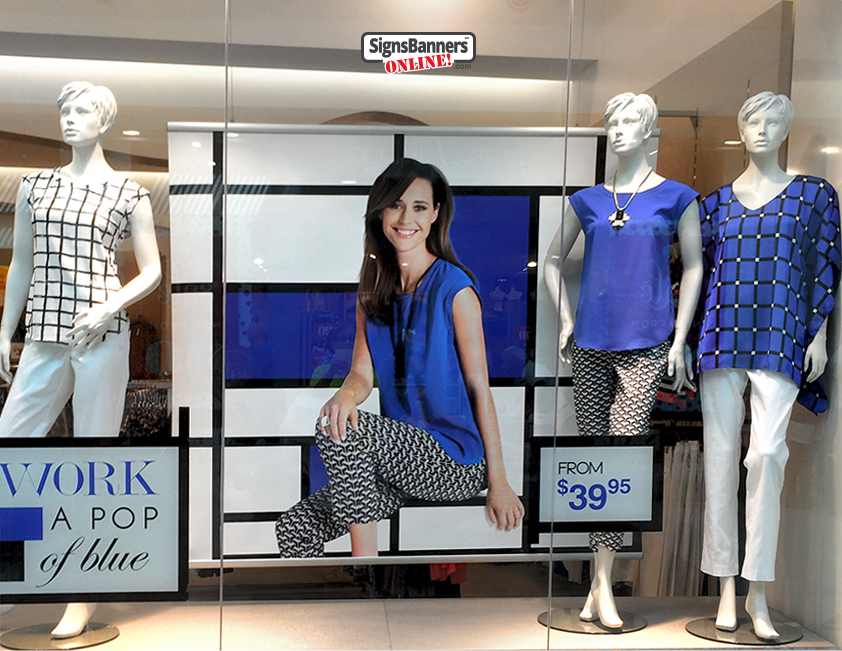 Mannequin display with background banner signage