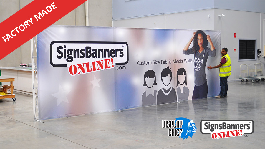 This custom printed media wall example stretches across three red carpet pop up stands and is customized to the clients stand size