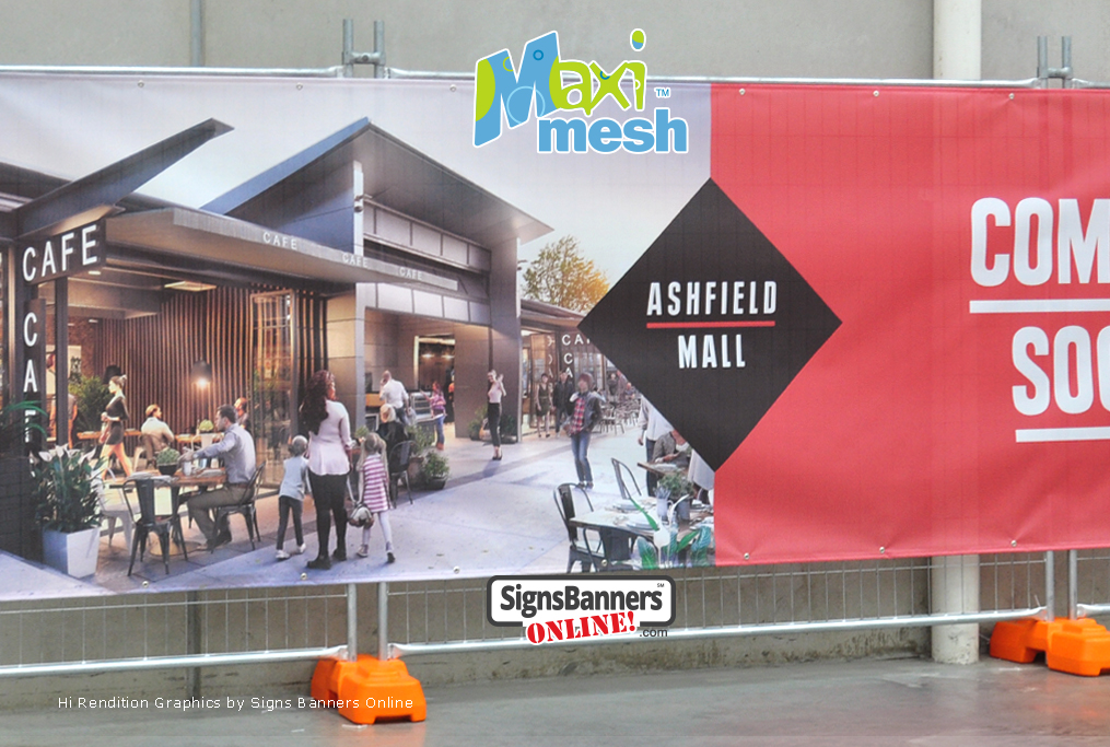 Hi-rendition graphics printed on mesh banner for mall renovation - the banner is tethered to the fence.