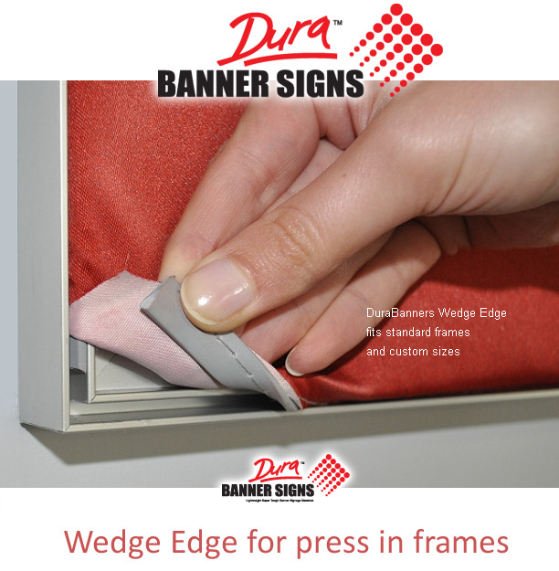 Fingers showing the press in features of the fabric banner fitted to aluminium frame surround. This makes signage swap over easy and is typically used in retail environments and for store branding changes.