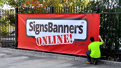 Click for original photo of large custom banner signs