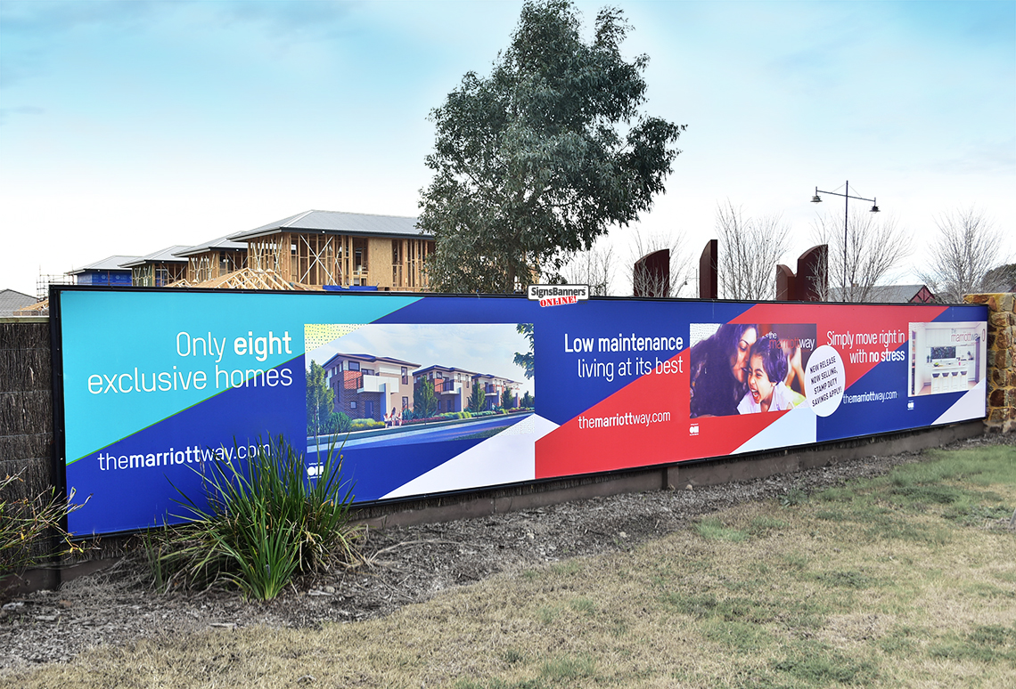 Real Esate Sales Office Banner on fence with new housing in background