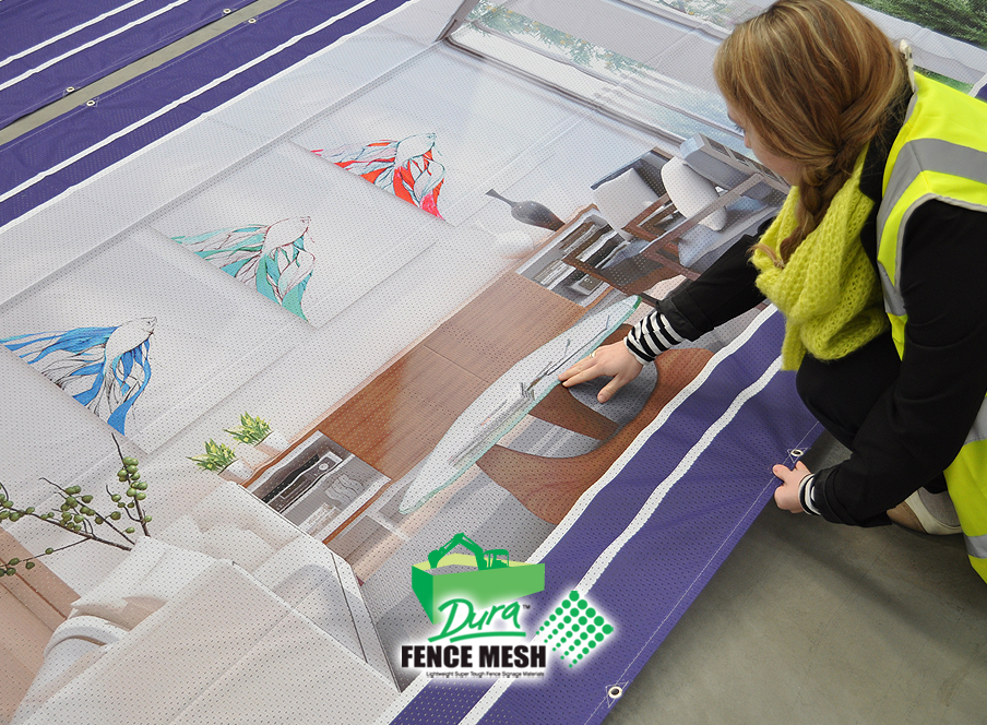This image of a lady next to the printed banner shows the crisp quality of the grand format graphics on contractor fence rental panel banners.