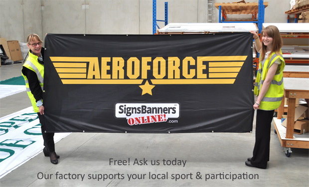 Our factory supports your team with banners. Ask us today. Here the girls are holding up a team banner with logo.