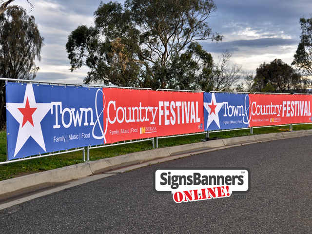Fairs: Upright portable crowd barricade systems with advertising signage banners fitted for event displays at a Town and Country Festival