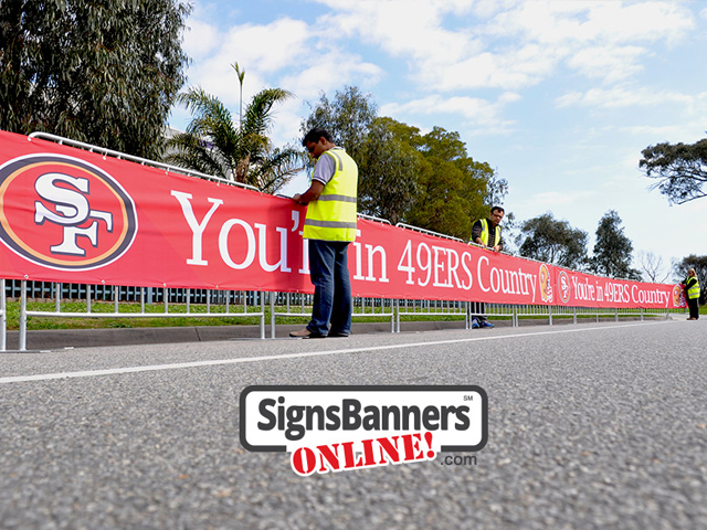 Signage on the temporary event fence covers