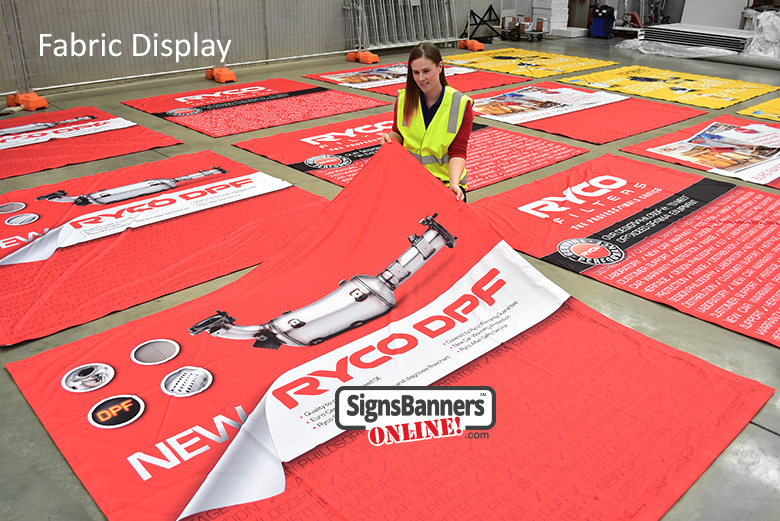 Fabric Display printing on polymer fabric via direct to garment sublimation printing techniques and technology