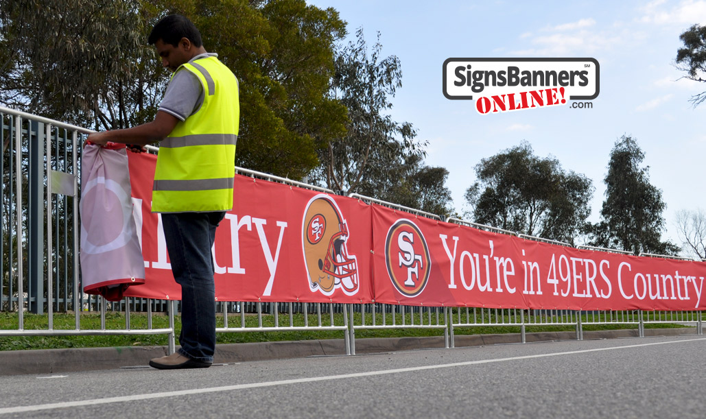 Winding up the event banner sign graphics for re-use next time - SF 49ers example.