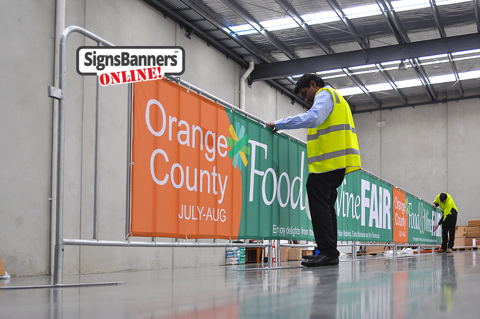Barricade signage. Barricade signage is a popular form to promote events and logos and is now very cheap. The benefits include NO SCRATCH which means that your banner signs can be stored and used annually like this example for Orange County CA