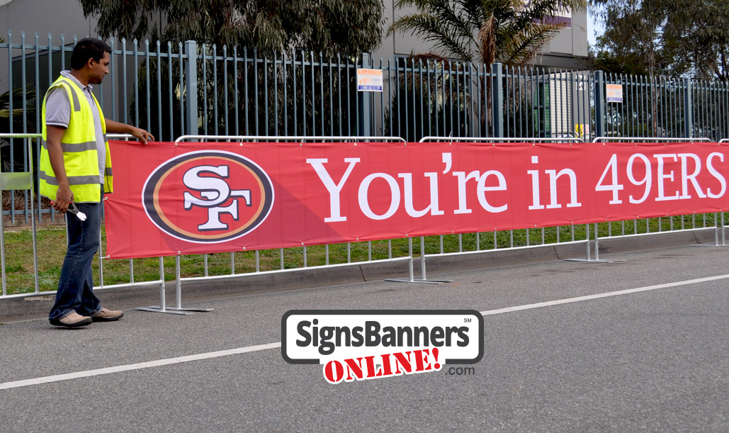 Event signage fixed to the barricades - 49ers San Francisco event promotion