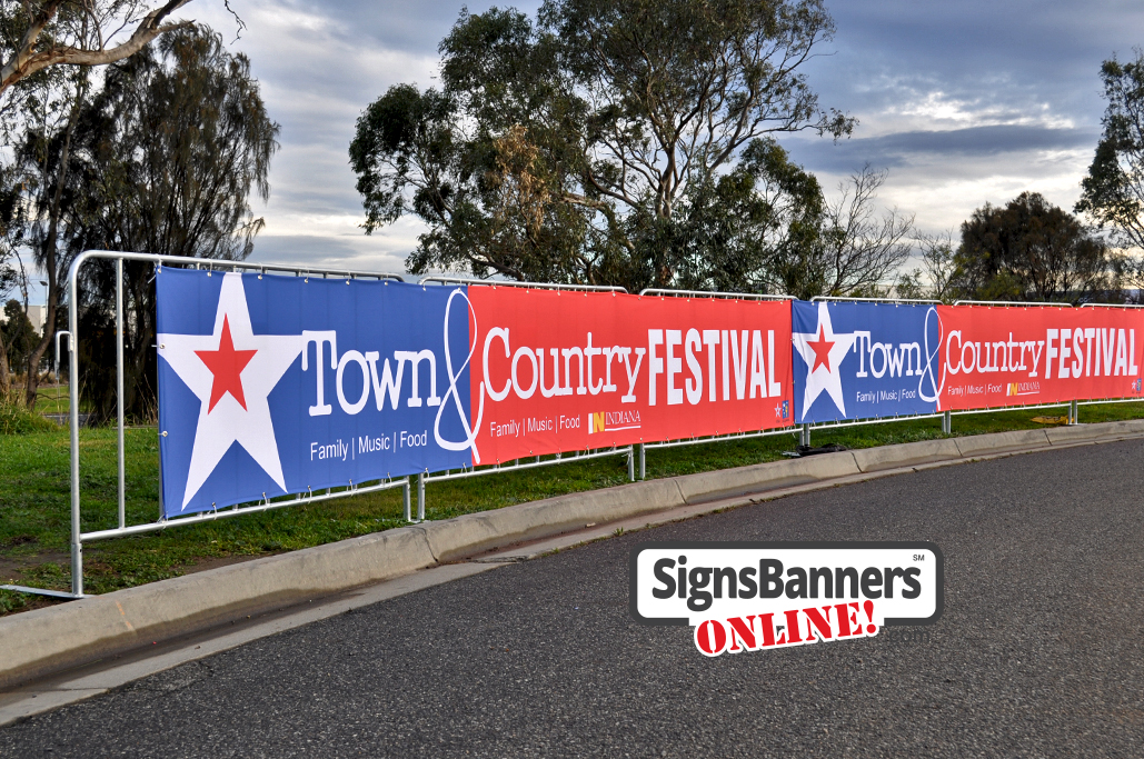 Upright portable crowd barricade systems with advertising signage banners fitted for event displays at the festival USA.