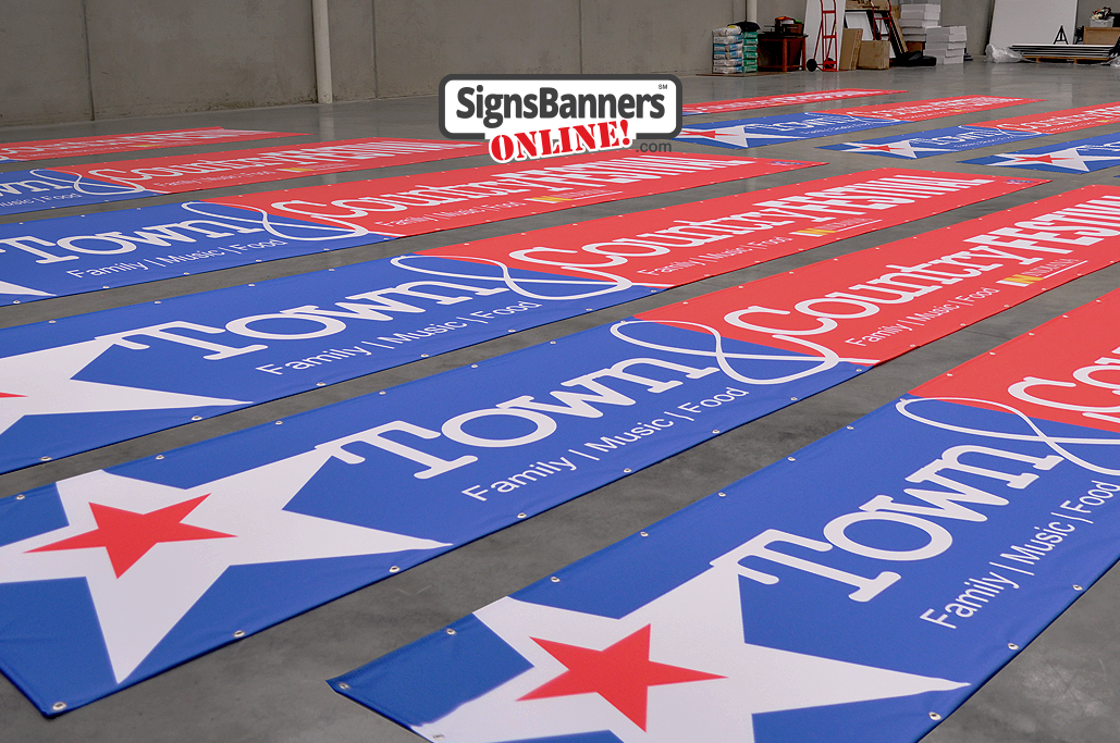 Banners and flags laid out on the packing floor ready to ship out to festival management company