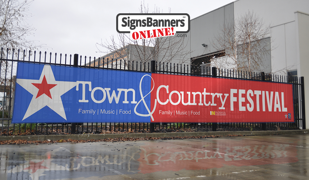 Surrounding your event perimeter early with advertising outdoor signs is clever. Big bold and bright is always best like this example for Indiana Town and Country Festival