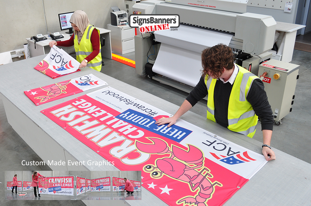 Original photo of print factory (inside) making a quantity of printed event graphics for use at events in Louisiana and South Carolina. The image shows a factory scene with work people during the final stages of wholesale banner sign supplies.