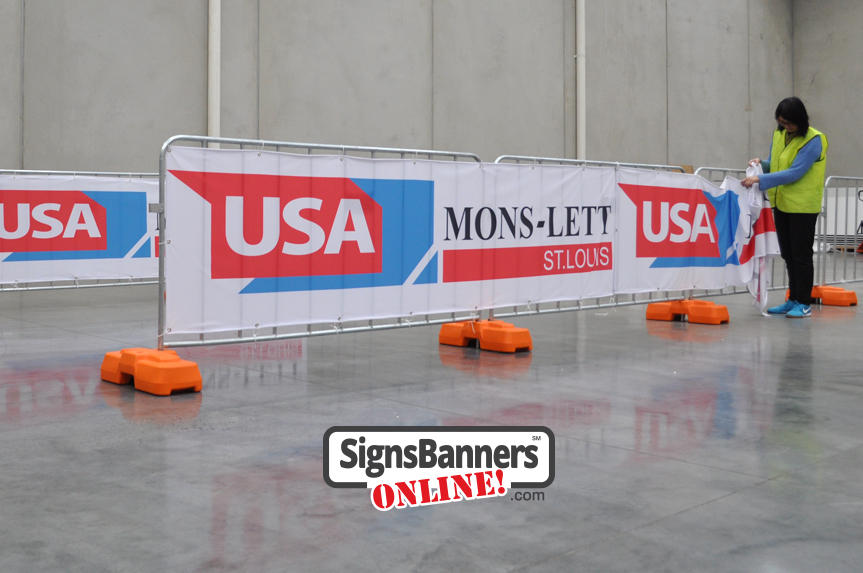 Event Crew. Showing the ease that any deployment crew can put up and down the signage using these flexible sign pieces.