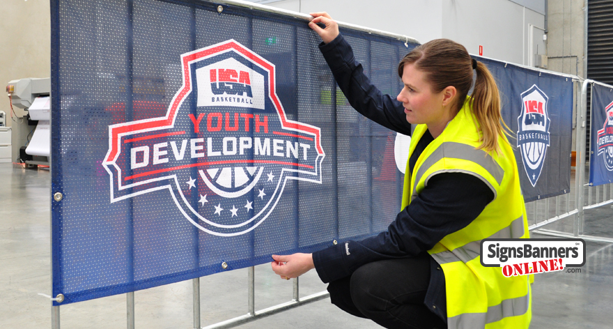 Portable outdoor display banner signs USA. Zip onto the crowd rail, these dark mesh banner signs with USA Basketball Youth Development logo look amazing. Factory Made.