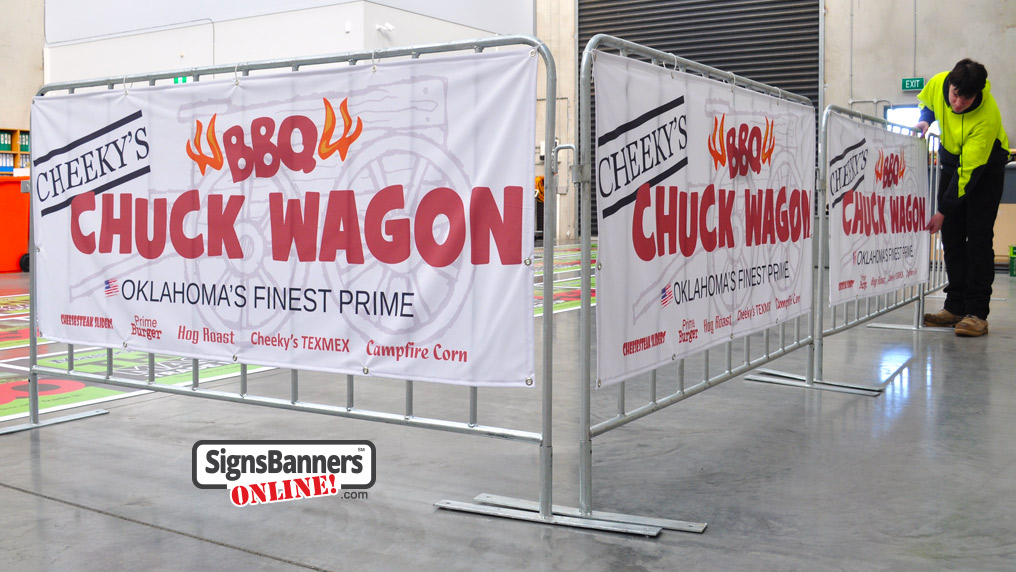 Set of printed banner signs showing the printing capability and artistic example that custom banner signage gives. The wagon in the background, big bold text and small food logos invite the reader very well. This example shows many features that Signs Banners Online give their Oklahoma customers.